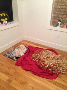 Why yes, I DID have my Batman wall art up before I had a bed in New York.